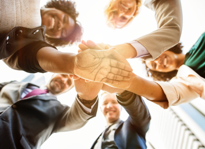 A Diverse Group of Business People With Their Hands Together in the Center