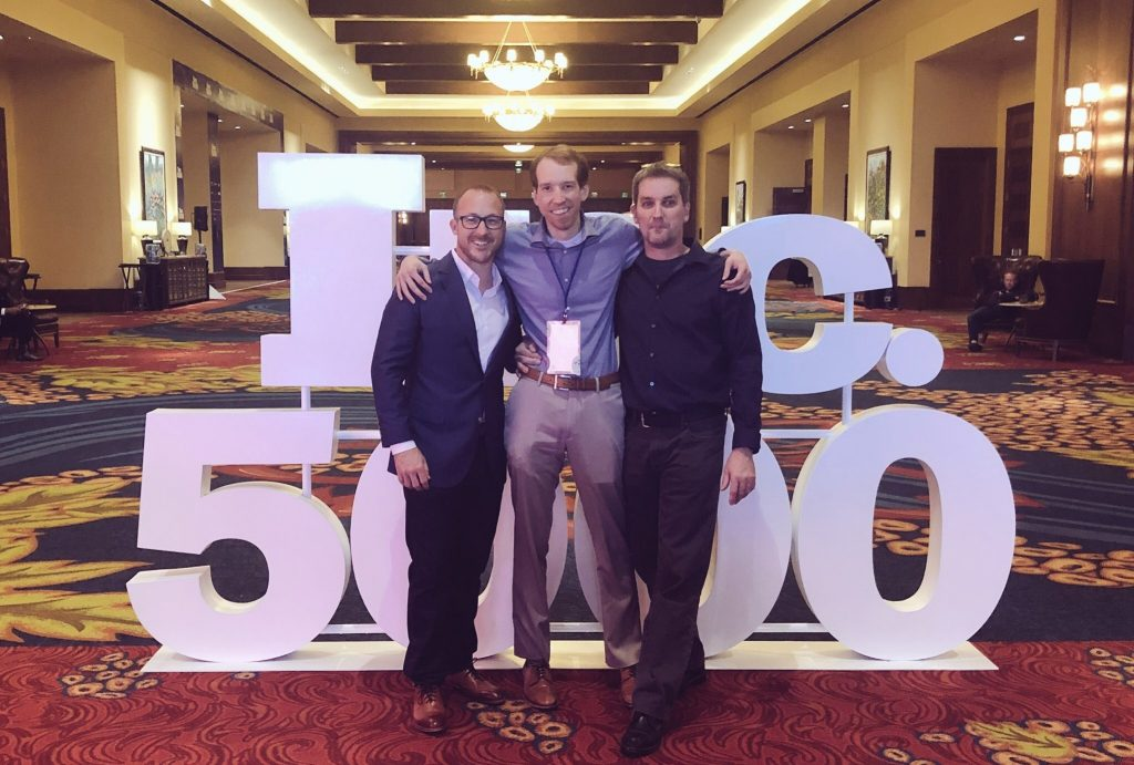 From left to right: SwanLeap Co-Founders Brad Hollister, CEO, Jason Swanson, CTO with Jim Rogan of Rogan's Shoes at the 2018 Inc. 5000 conference where SwanLeap was honored as the #1 fastest-growing company in America.